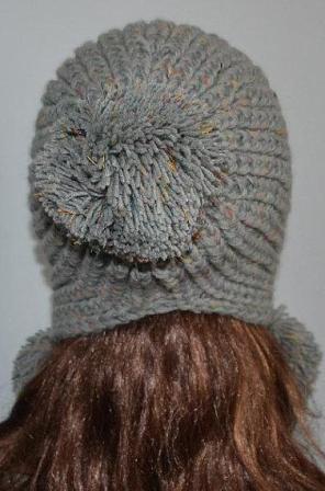Описание: детская шапка вязаная с ушками и мордочкой.